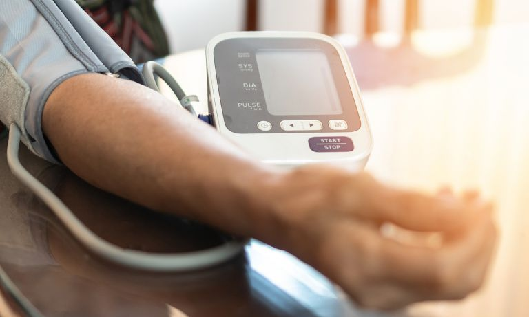 mans-arm-on-table-blood-pressure-cuff-768